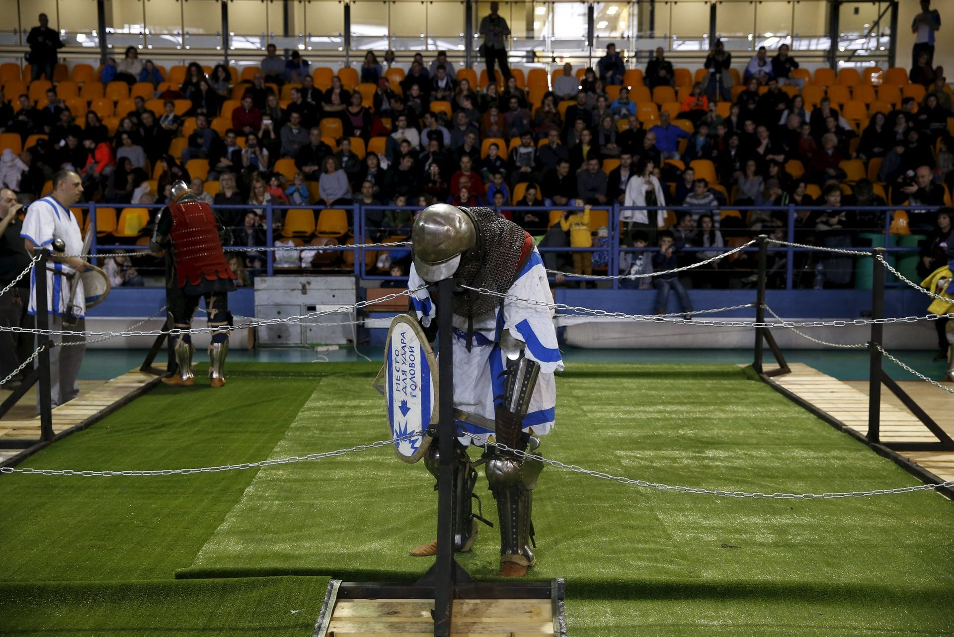 A man dressed as a knight rests during a fight at an international medieval tournament in Tel Aviv, January 23, 2016.