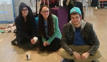 From left, Rivky Wigder, Racheli Shafier  and Jamie Gutt camping out at Ben-Gurion airport while waiting for flights to the U.S. to resume.
