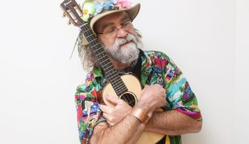 "Paul Moore with his ukelele: ""This instrument saved my life."""