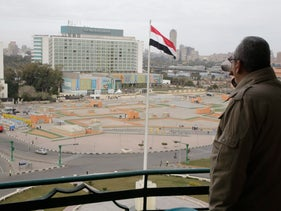 Egyptian drinks a cup of tea as he looks towards Tahrir Square, which was the focal point of the Jan. 25, 2011 Egyptian uprising that toppled autocrat Hosni Mubarak, in Cairo, Egypt, Monday, Jan. 25, 2016.