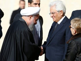 Iran President Hassan Rohani (L) shakes hands with Italian President Sergio Mattarella at the Quirinale presidential palace in Rome, Italy, January 25, 2016.