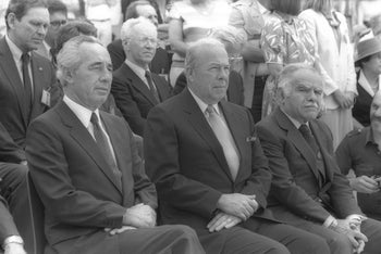 Prime Minister Shimon Peres, U.S. Secretary of State George Schultz and Foreign Minister Yitzhak Shamir at a memorial service for WWII Jewish fighters, Jerusalem, Israel, May 10, 1985.