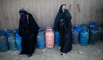 Palestinian women waiting to have their gas bottles refilled,, January 25, 2016.