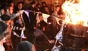 Ultra-Orthodox protesters burn an Israeli flag, 2008.