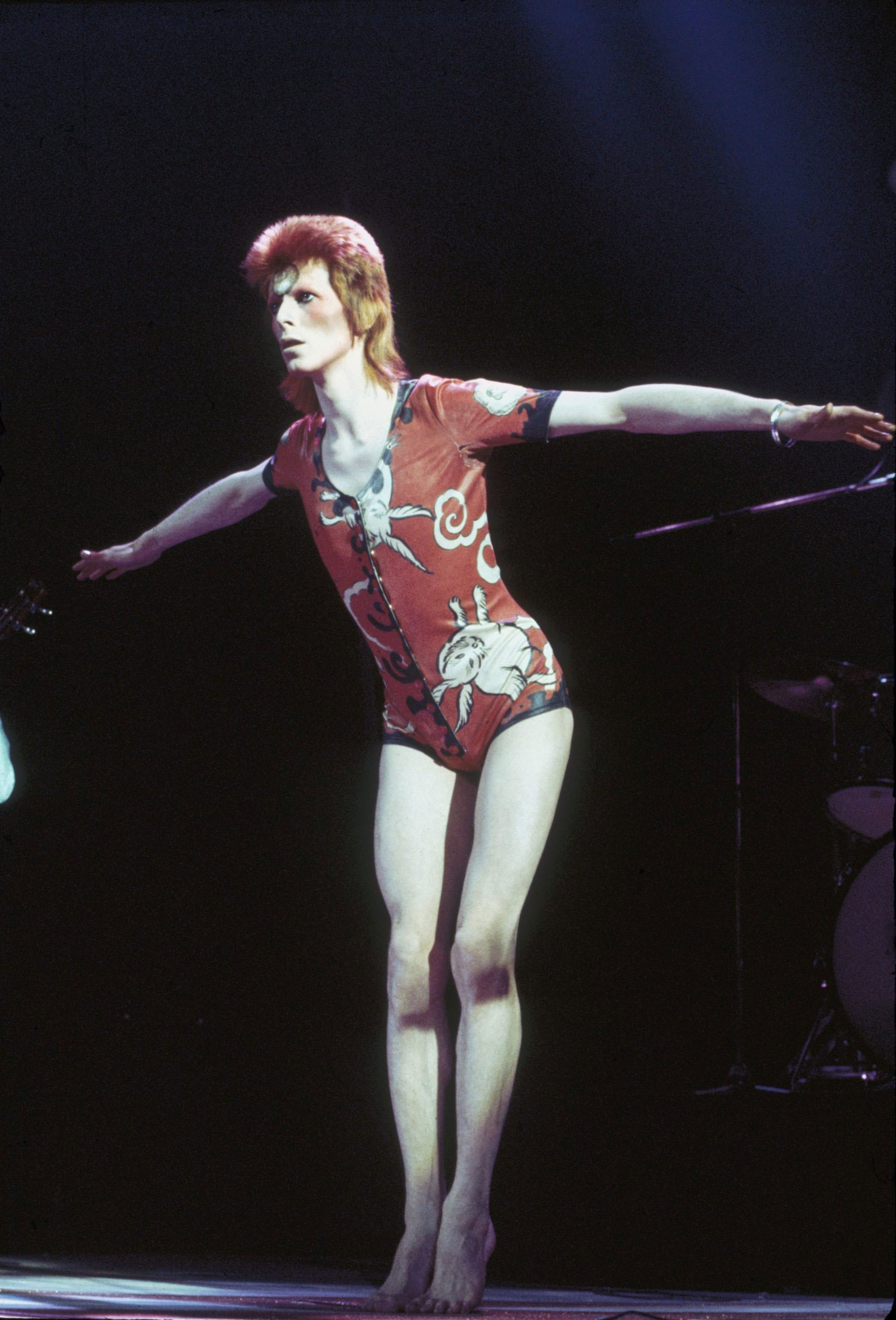 David Bowie performing as Ziggy Stardust, in his 'woodland creatures' costume designed by Kansai Yamamoto, at the Hammersmith Odeon, 1973.