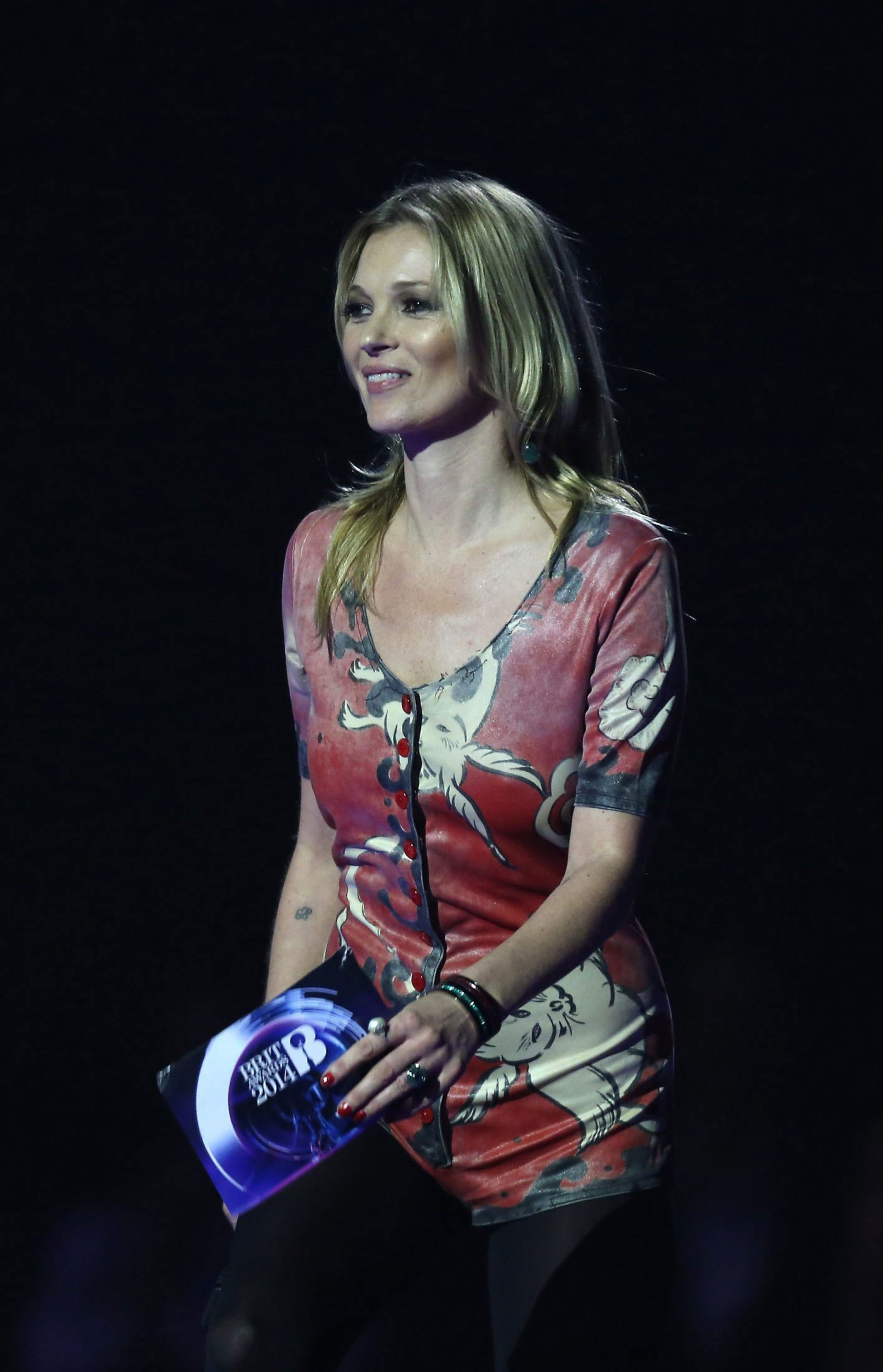 Kate Moss is seen on stage accepting the award for British Male Solo Artist on behalf of winner David Bowie at the BRIT Awards 2014 at the O2 Arena in London on Wednesday, Feb. 19, 2014.