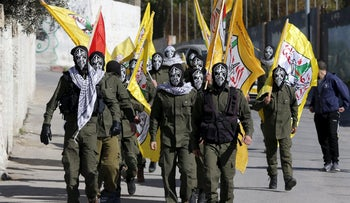 Palestinian militants take part in the funeral of Srur Abu Srur, who was killed by Israeli army, in Aida refugee camp in the West Bank city of Bethlehem, January 13, 2016.