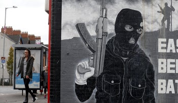 A paramilitary mural is seen on a wall in East Belfast in Northern Ireland, October 20, 2015.