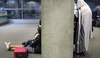 FILE PHOTO: Ultra-Orthodox Jews wait at Ben Gurion Airport. January, 2015.
