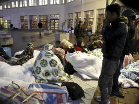 Refugees sleep outside the entrance of the Swedish Migration Agency's arrival center for asylum seekers in Malmo, Sweden.