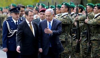 Cypriot President Nicos Anastasiades and Prime Minister Benjamin Netanyahu review a military guard of honor in Cyprus on January 28, 2016.