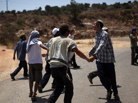 Hilltop youth dance during a march from Nablus to Jericho in 2010.