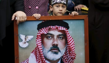 Palestinian boy in Gaza hold a picture of the head of Hamas' politburo Sheikh Ismail Haniyeh. December 2016.