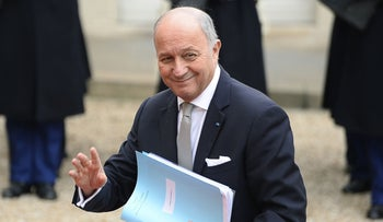 French Foreign Affairs minister Laurent Fabius waves as he arrives before a meeting with the Iranian president at the Elysee Palace in Paris on January 28, 2016.