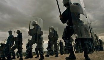 Palestinian police loyal to President Mahmoud Abbas dressed in riot gear, show their skills during an exercise in the West Bank town of Jericho, Feb. 12, 2008.