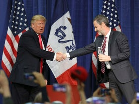 U.S. Republican presidential candidate Donald Trump shakes hands with Jerry Falwell Jr. at a campaign rally in Council Bluffs, Iowa, U.S., January 31, 2016.