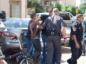 Israel Police arresting a terror suspect in Givatayim, on October 15, 2015.