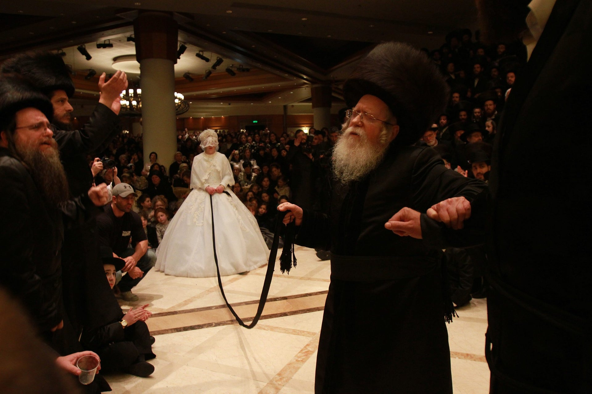Ultra orthodox Jews attend the wedding of the Son of the Rabbi of Sassov (Hasidic dynasty) and the granddaughter Admor Rabbi Kretshnif (Hasidic dynasty) in Bnei Brak, February 1, 2016.
