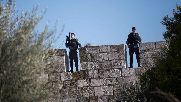 Israeli border policemen stand guard on the walls of Jerusalem's Old City following an attack by three Palestinian assailants at Damascus Gate, February 3, 2016.