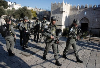 Border Police officers patrol a street in Jerusalem following an earlier terror attack at the Old City's Damascus Gate on February 4, 2016.