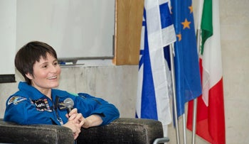 Samantha Cristoforetti, wearing her blue European Space Agency flight suit, meeting with students and fans in Tel Aviv.