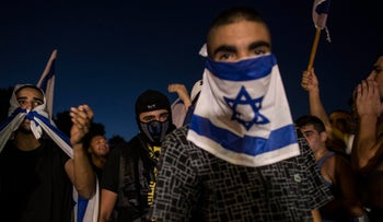 Israeli right-wing activists shout slogans during a rally against supporters of Mohammed Allan, a Palestinian prisoner on a hunger strike, in Ashkelon, Aug. 16, 2015.