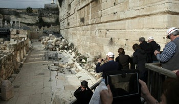 Tourists take pictures of the right part of the Western Wall, on the archaeological site known as Robinson's Arch, in the Old City of Jerusalem, on February 2, 2016.