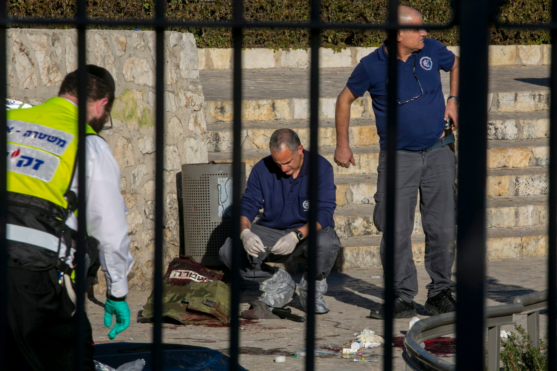 Forensics specialists examine a protective vest worn by one of the border policewomen wounded in the terror attack near Damascus Gate in Jerusalem, February 3, 2016.