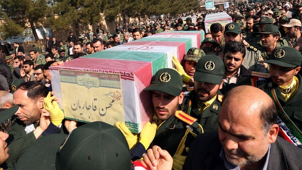 Members of the Iranian Revolutionary Guard carry the caskets of Iran's Revolutionary Guards Brigadier General Mohsen Ghajarian, who was killed in the northern province of Aleppo, on February 6, 2016.