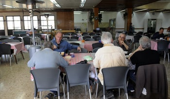 Kibbutz members eating at the dining room of Sha'ar Ha'amakim, where the talk of the town is Bernie Sanders.