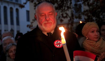 Demonstrators take part in a protest organized by a Jewish group against a planned statue of Balint Homan in Szekesfehervar, Hungary, December 13, 2015.