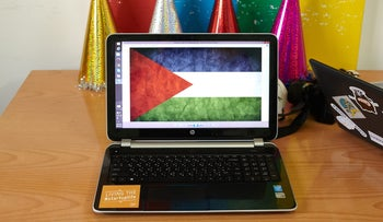 A digital rendering of a Palestinian flag sits on the screen of a laptop computer in the offices of Gaza Sky Geeks in Gaza City, on Thursday, June 25, 2015.