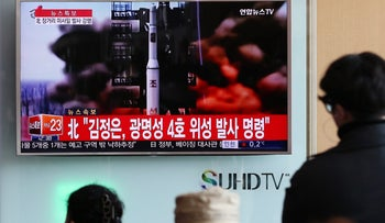 People watch a television screen showing a news broadcast on North Korea's long-range rocket launch at Seoul Station in Seoul, South Korea, Feb. 7, 2016.