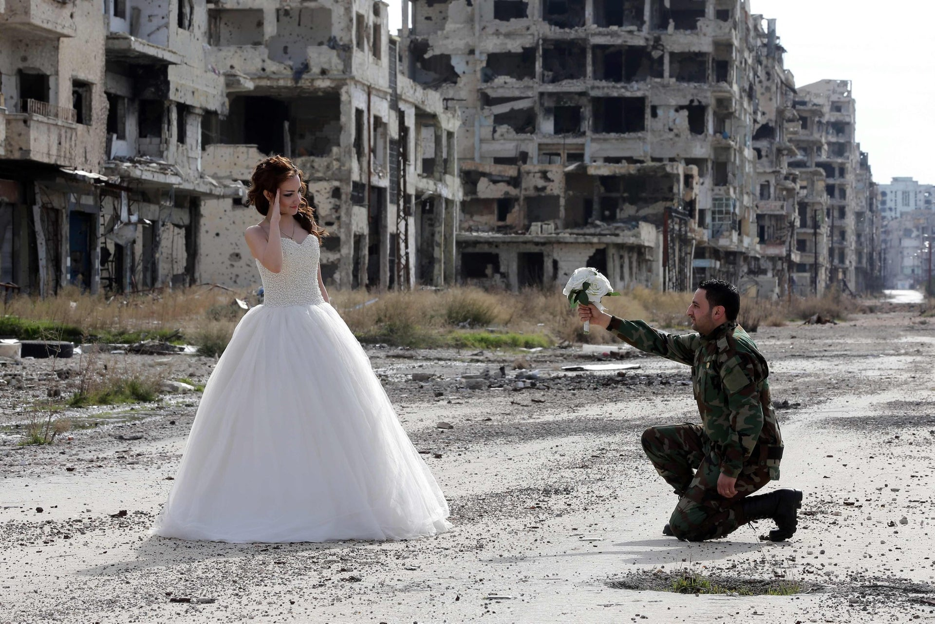Newly-wed Syrian couple Nada Merhi,18, and Hassan Youssef,27, pose for a wedding picture amid heavily damaged buildings in the war ravaged city of Homs on February 5, 2016.