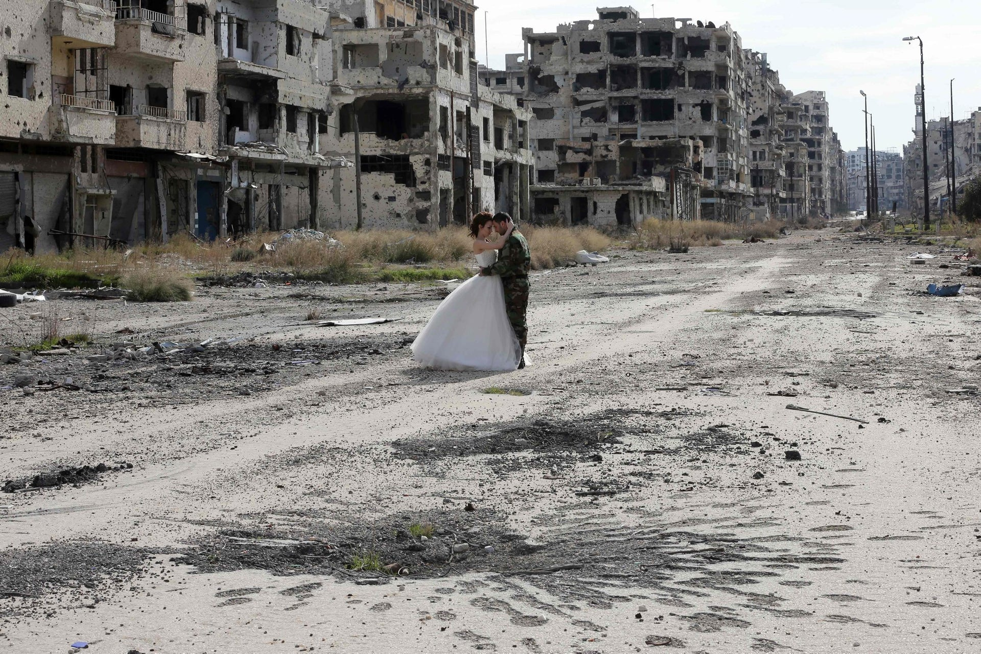 Shelled buildings in Homs, Syria, serve as the unlikely backdrop for the wedding photos of Nada Merhi and Hassan Youssef on February 5, 2016.