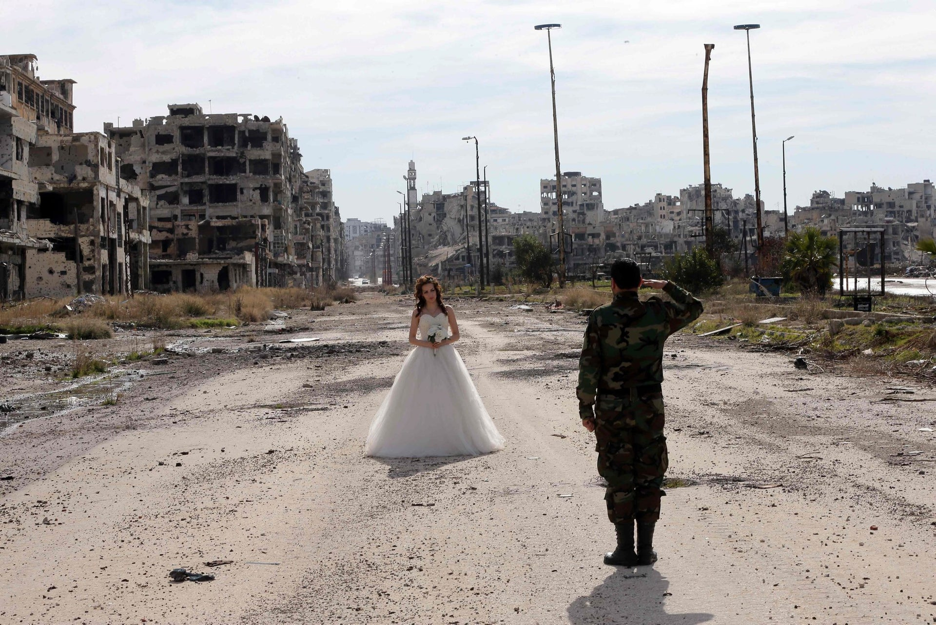 Nada Merhi and Hassan Youssef have their wedding photos taken in a desolate street in the Syrian city of Homs on February 5, 2016.
