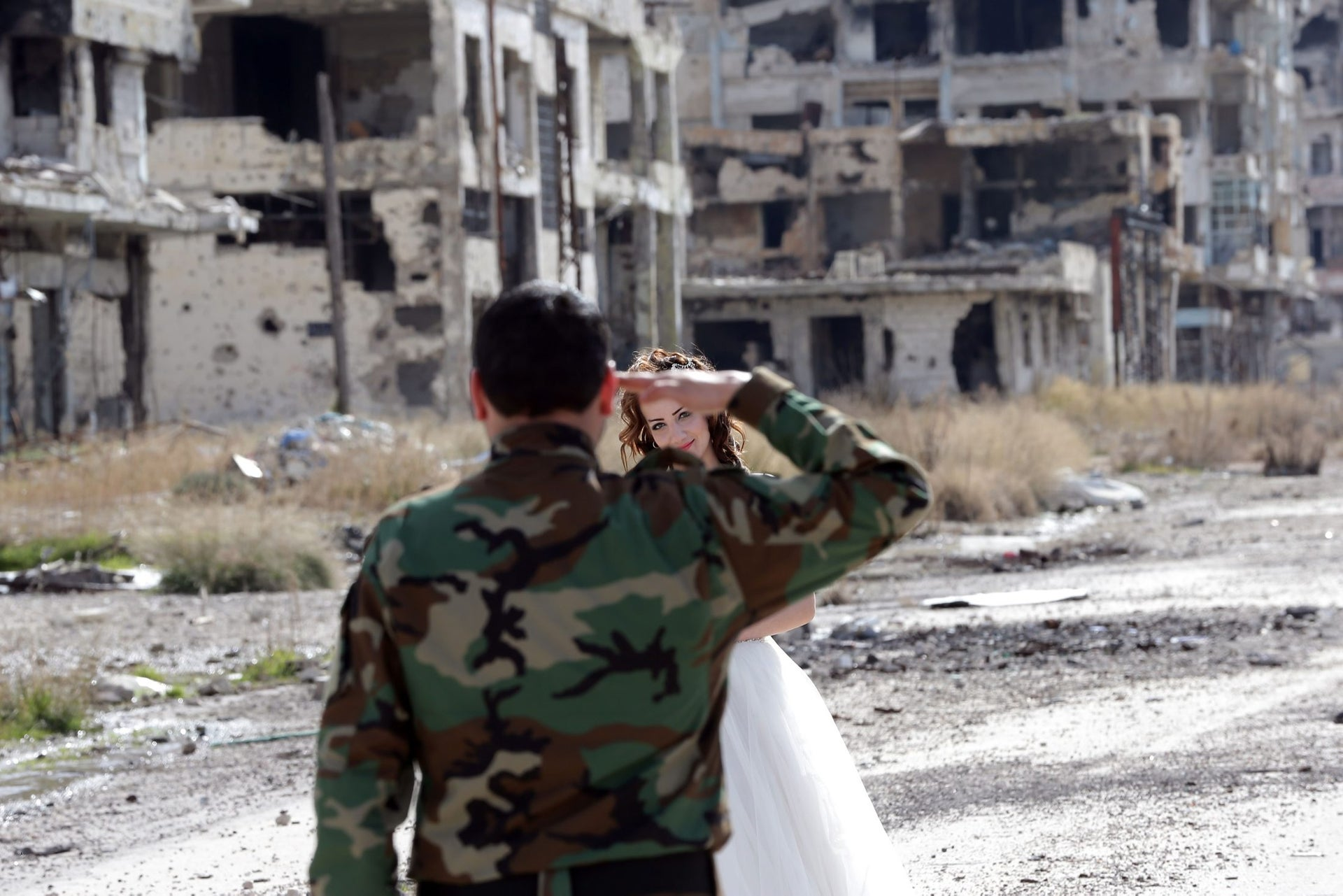 Groom Hassan Youssef salutes his bride Nada Merhi in Homs, Syria, on February 5, 2016.
