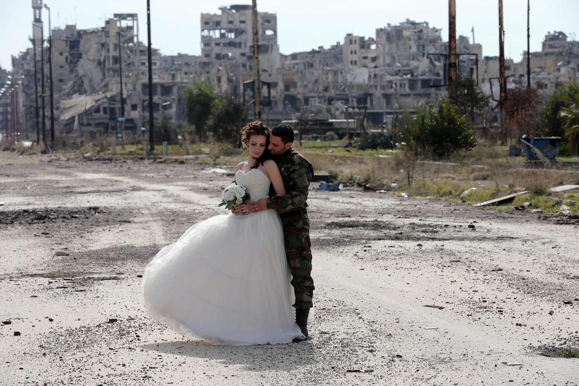 A tender moment for newlyweds Nada Merhi and Hassan Youssef in the ruined Syrian city of Homs on February 5, 2016.