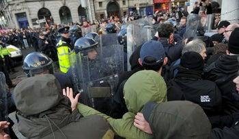 Members of the Garda Public Order Unit and riot police confront protesters at an anti-racism demonstration against the launch of an Irish branch of PEGIDA in Dublin, Ireland February 6, 2016.