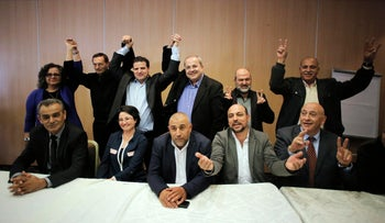 Arab-Israeli parliament members and candidates join hands after the announcement of the Joint Arab List in upcoming elections, February 2, 2015.