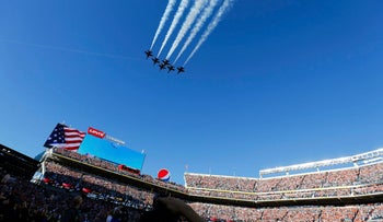 The U.S. Navy Blue Angels perform a flight over Levi Stadium before the start of the 50 NFL's Super Bowl. Observers of satellite tracking data say North Korea's newest satellite flew over the stadium after the game.