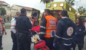 Paramedics evacuate an 11-year-old boy wounded in a suspected stabbing in Ramle, February 8, 2016.