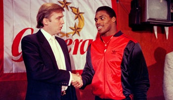 Donald Trump shakes hands with Herschel Walker after signing a 4-year contract with the USFL's New Jersey Generals, March 8, 1984.