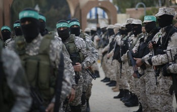 Palestinian Hamas militants take part in a rally in memory of their seven comrades, who were killed when a tunnel collapsed close to the Gaza Strip's eastern border with Israel, in the east of Gaza City January 31, 2016.