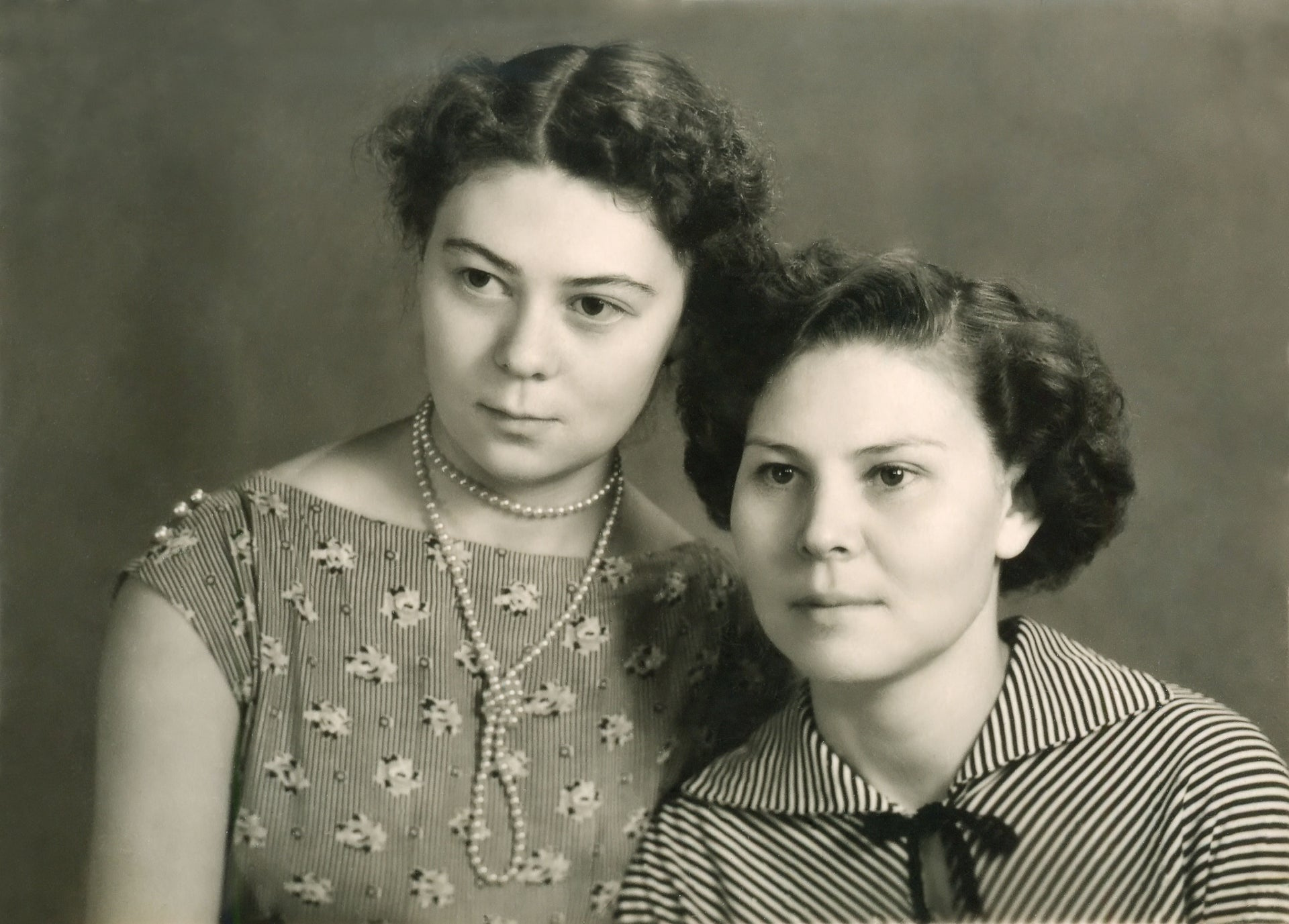 An illustrative black and white photo showing two women posing for a portrait.