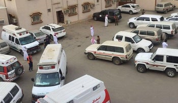 Ambulances in the parking lot of the building where a teacher shot six in Jazan Province, Saudi Arabia, February 11, 2016.