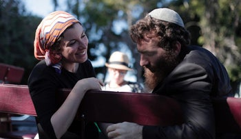 LA's Judith Prays and Yonatan Mallinger on their Besht wagon, inspired by a painting of the Baal Shem Tov.