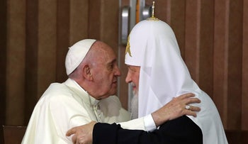 Pope Francis, left, and the head of the Russian Orthodox Church Patriarch Kirill kiss after signing a joint declaration on religious unity in Havana, Feb. 12, 2016.