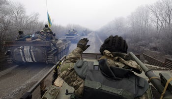 A convoy of Ukrainian forces drives to Debaltseve, Donetsk region, on February 14, 2015.
