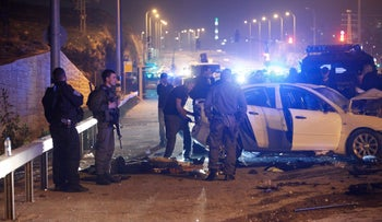 Israeli police stand at the scene of an alleged car ramming attack near Jerusalem, Saturday, Feb. 13, 2016.